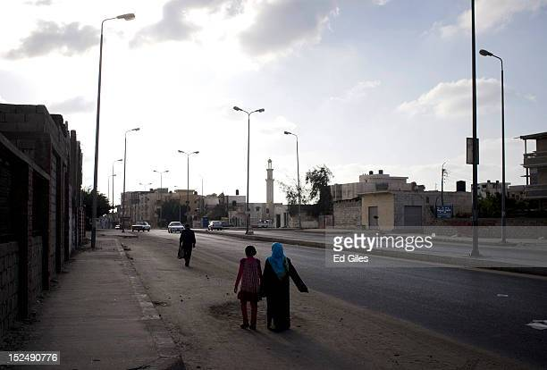 Two Egyptian women walk down a street in the city of El Arish, the capital of Egypt's restive North Sinai region, September 19, 2012. The area is at...