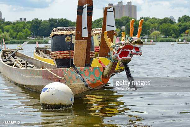 Two elaboratelycarved traditional style dragon boats made from teak wood sit at anchor in Meadow Lake The twoday 25th Annual Hong Kong Dragon Boat...