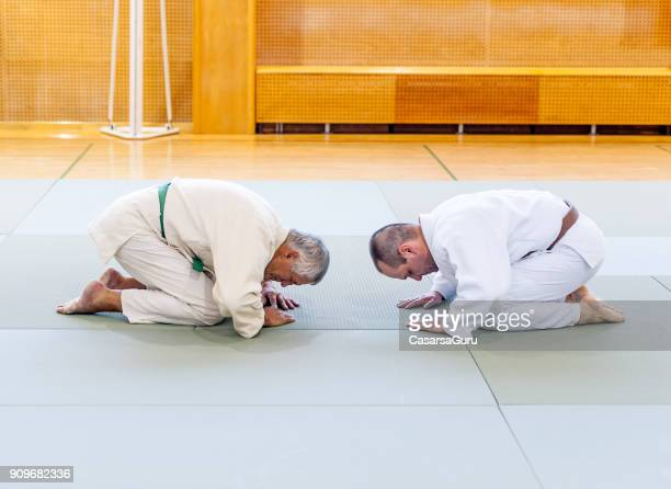 Two Elder Judo Fighters Bowing Down to Eachother