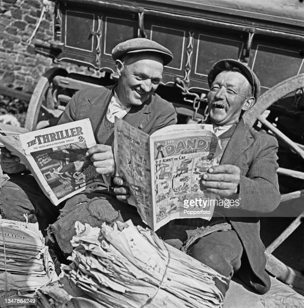 Two elder residents take time out to enjoy reading copies of The Dandy comic and The Thriller paper as they collect waste paper for salvage and...