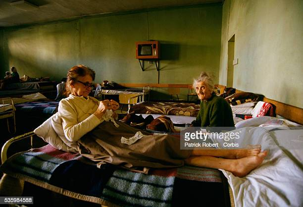 Two elderly Bosnian women rest on cots in the sleeping area of a nursing home for retired citizens in Mostar Thousands of Bosnian and Serb civilians...
