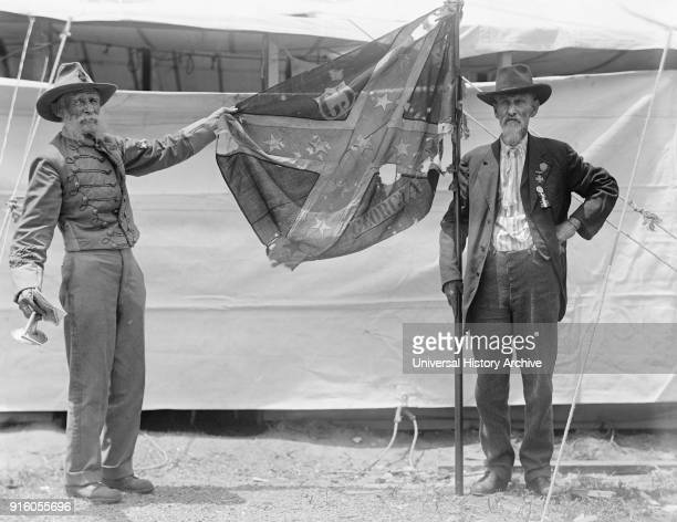 Two Elderly Confederate Veterans Holding Georgia Battle Flag of American Civil War during Confederate Reunion Washington DC USA Harris Ewing June 1917
