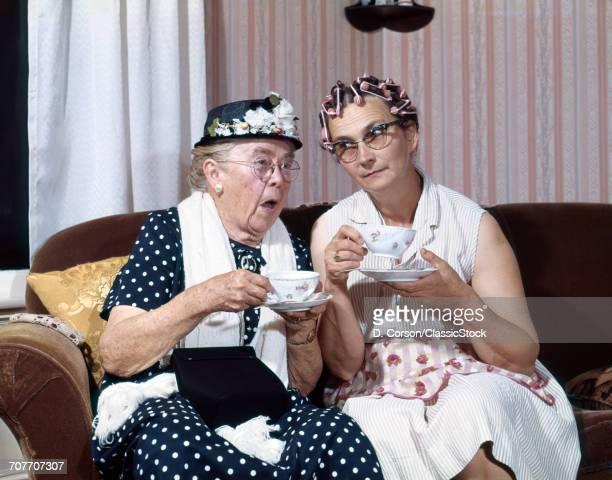 1950S two ELDERLY DRINKING...