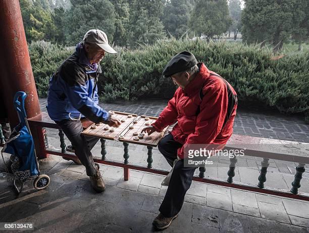 Two elderly gentlemen playing Chinese chess, Beijing, China
