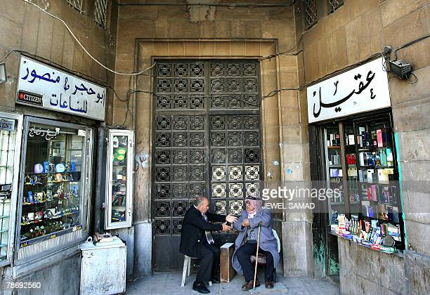 Two elderly men chat outside their shops at a market in central Amman 02 January 2008 Jordan is a small Arab country with insufficient supplies of...