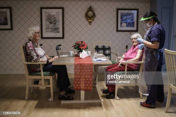 Two elderly women in one of Attendo's nursing home in Gothenburg receive their first of the doses of the Pfizer-BioNtech COVID-19 vaccine on January...