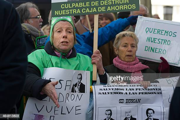 Two elderly women protest outside a Madrid court where exBankia president Miguel Blesa was giving evidence relating to the collapse of the Spanish...