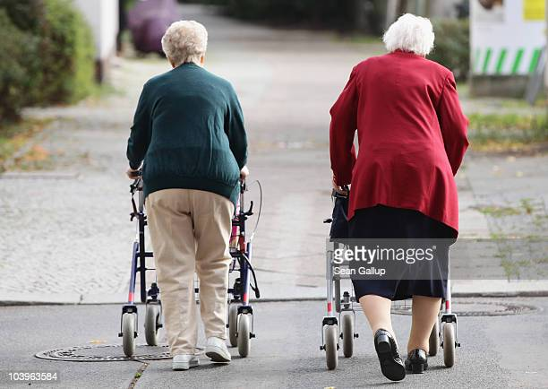 Two elderly women push shopping carts down a street on September 10, 2010 in Berlin, Germany. Germany's elderly population is growing and its overall...
