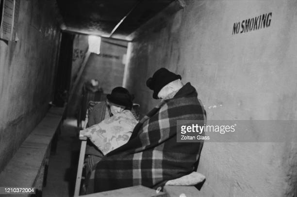 Two elderly women sleeping in an air raid shelter during the Blitz London October 1940 Original Publication Picture Post 308 Shelter Life pub 26th...