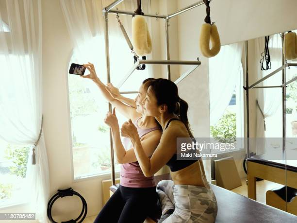 two elderly women taking a self-portrait with their smartphone - maebashi city stock photos and pictures