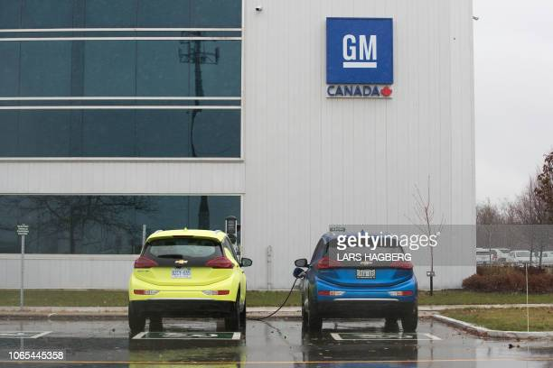Two electric vehicles are getting charged at the General Motors plant in Oshawa Ontario on November 26 2018 General Motors is to announce on Monday...