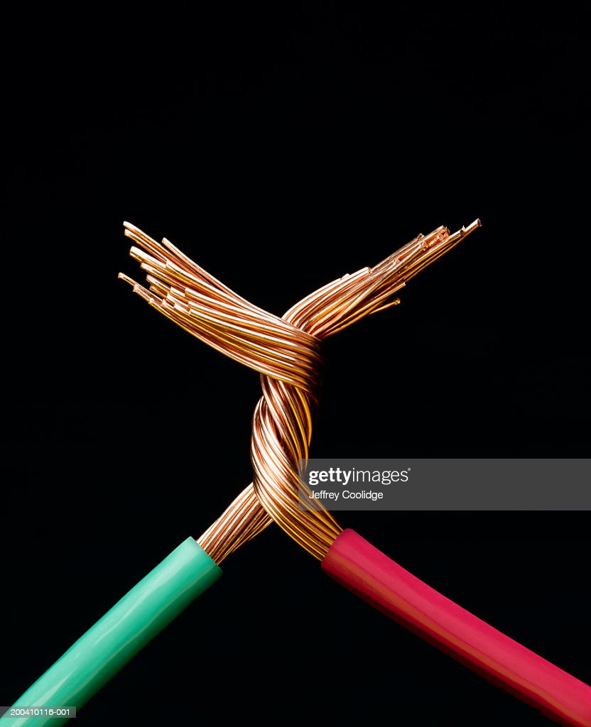 Two electrical cables with copper wires twisted together, close-up : Stock Photo