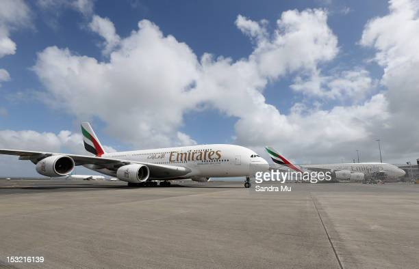 Two Emirates A380's are seen on the tarmac at Auckland International Airport on October 2 2012 in Auckland New Zealand Emirates will increase its...