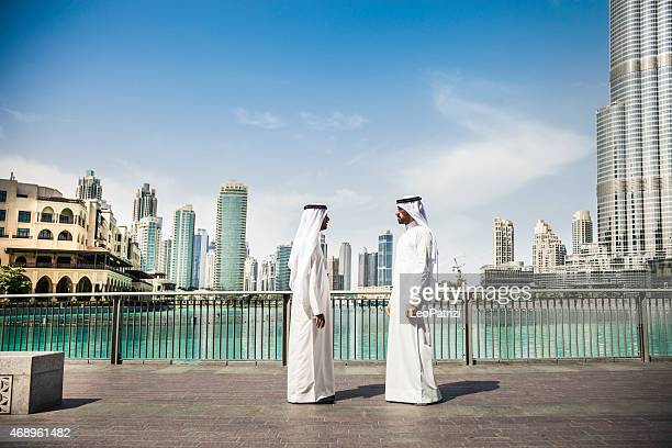 Two Emirates business men doing business in downtown
