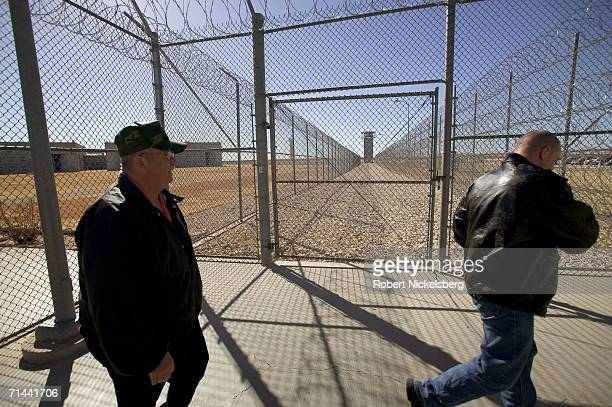 Two employees arrive to the security fences at the Robertson Unit maximum security prison on January 11 2006 in Abilene Texas Part of the Texas...