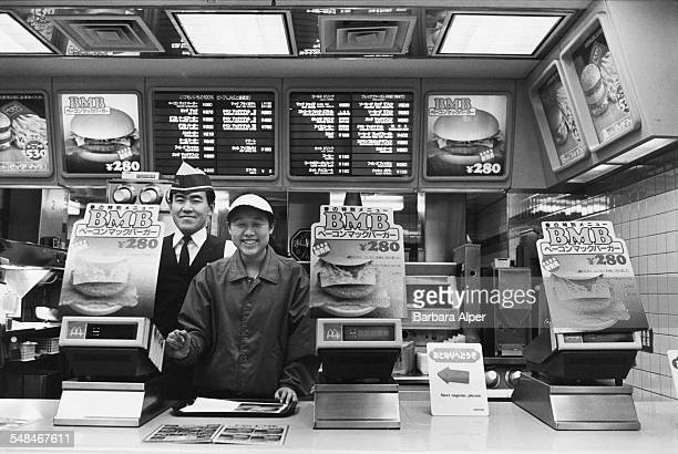 Two employees behind the counter at a McDonald's fast food restaurant in Tokyo February 1988