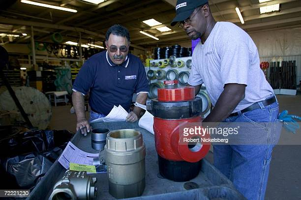 Two employees of Midway Supply Company fill an order of valves and fittings for a coal bed methane customer on June 15 2006 in Gillette Wyoming The...