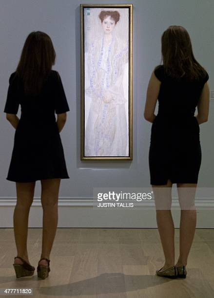 Two employees of Sotheby's auction house pose by a portrait of Gertrud Loew by Austrian artist Gustav Klimt painted in 1902 with an estimate of £1218...