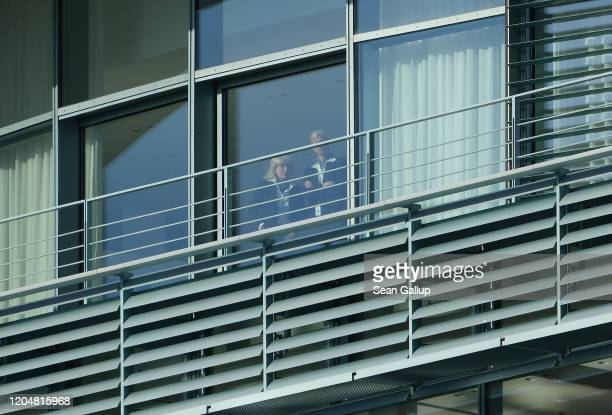 Two employees of the Chancellery look out from the meeting room where the government coalition commission was likely to hold its meeting on February...