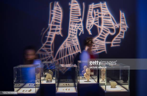 Two employees of the museum pedagogy department take a look at exhibits in Mainz Germany 16 May 2017 Depictions of Women are displayed in glass...