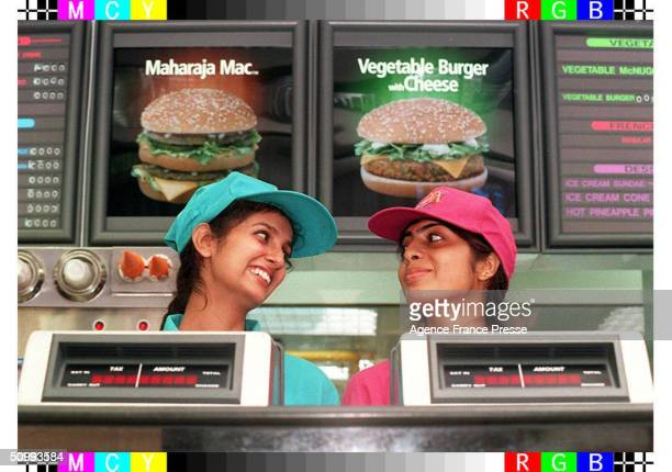 Two employees stand behind the counter of the first McDonald's fastfood restaurant in New Delhi India October 11 1996 The store which opened...