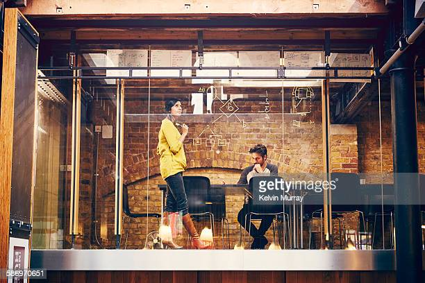 two employees work on a project in modern office - creative occupation stock pictures, royalty-free photos & images