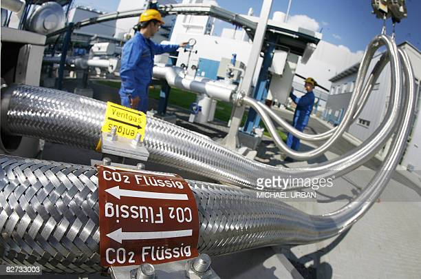 Two employees work on pipes carrying liquid CO2 on September 08 2008 at the 'Schwarze Pumpe' power station run by Europe's biggest power company...