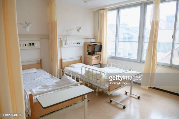 two empty beds in hospital ward - hospital ward stock pictures, royalty-free photos & images