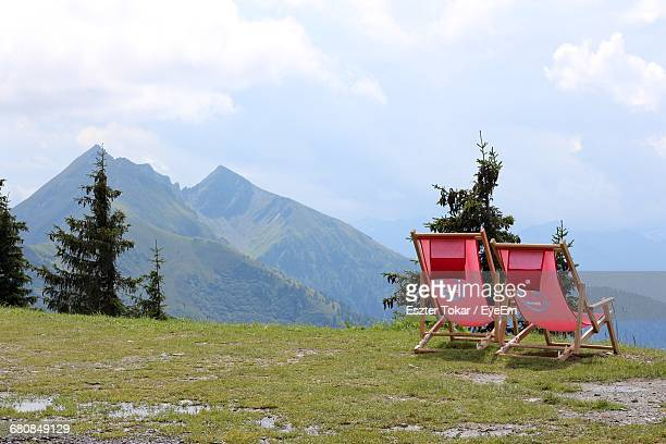 Two Empty Lounge Chairs On Top Of The Mountain