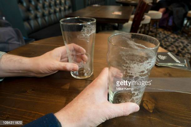 Two empty pint glasses of beer in a pub in London United Kingdom