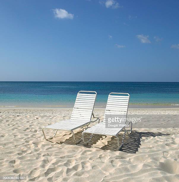Two empty sunloungers on beach