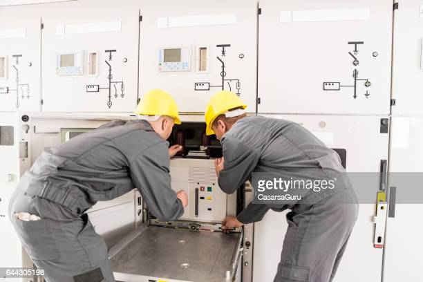 Two Engineers Dealing With The Electricity Transformer