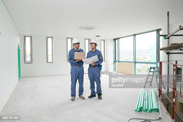 Two engineers having a meeting at building construction site