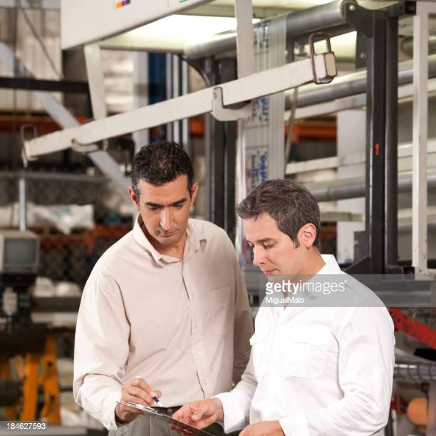 Two engineers in outsourcing printing industry