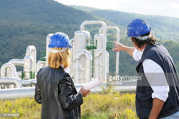 Two Engineers Planning in Geothermal Power Station