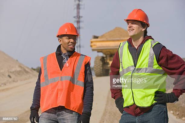 Two engineers talking at a construction site