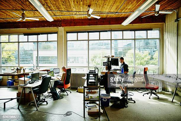 Two engineers working on project at workstations