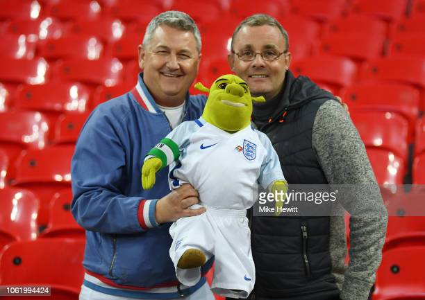 Two England fans pose with a Shrek doll after the International Friendly match between England and United States at Wembley Stadium on November 15...