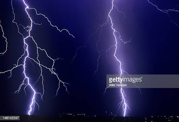 Two enormously powerful cloudtoground lightning strikes with multiple air discharge channels Tucson Arizona USA