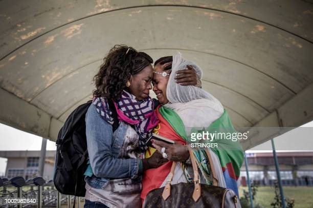 TOPSHOT Two Eritrean sisters living in the diaspora get reunited in their home country after more than two decades without seeing each other upon the...