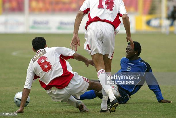 Two Etoile Sahel defenders Ahmed Hammi and Kais Zouaghi stops Enyimba's David Tyavkase from advancing into its hafh 12 December 2004 during the CAF...
