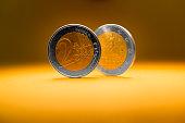 two euro coins balancing