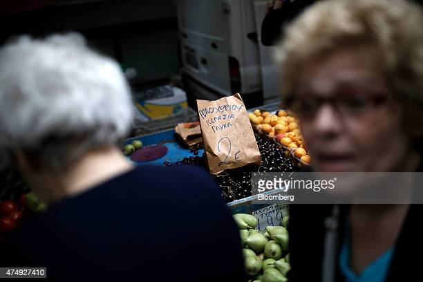 A two euro price sign sits on a display of cherries for sale at a farmer's market on Kassandrou street in Thessaloniki Greece on Thursday May 28 2015...