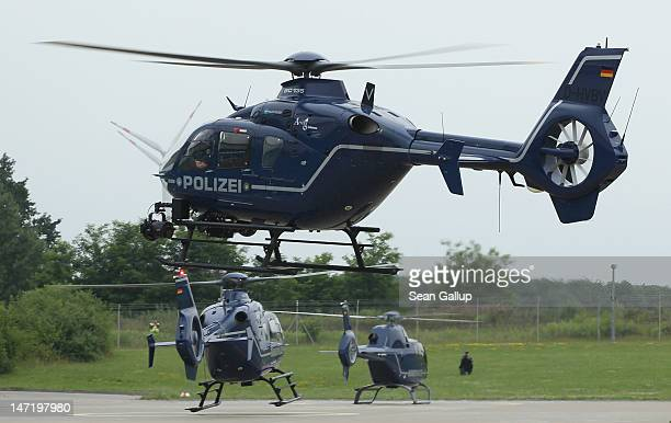 Two Eurocopter EC 135 helicopters and one EC 120 of the Bundespolizei the German federal police force touch down during a demonstration of...