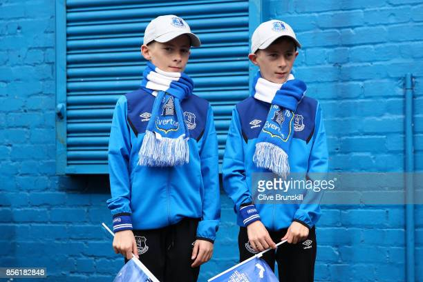 Two Everton fans are seen outside the stadium prior to the Premier League match between Everton and Burnley at Goodison Park on October 1 2017 in...