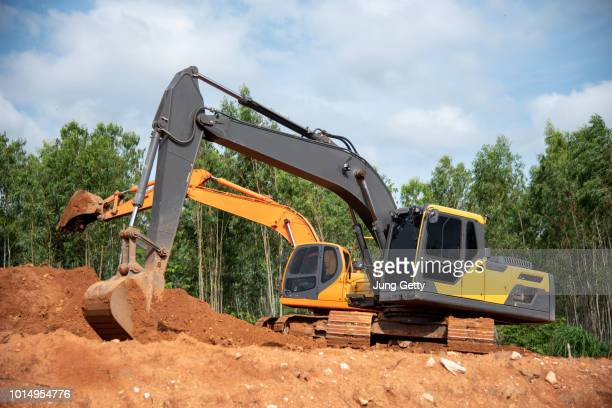 two excavator at construction site - ancient civilisation stock pictures, royalty-free photos & images