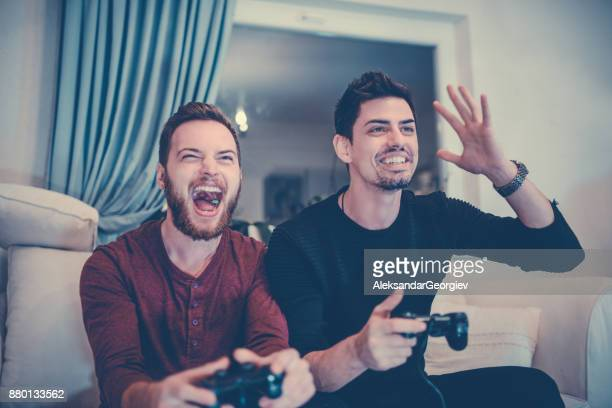 Two Excited Friends Playing Video Games