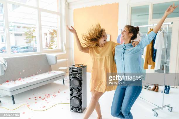 two excited young women having a party - girlfriend stock pictures, royalty-free photos & images