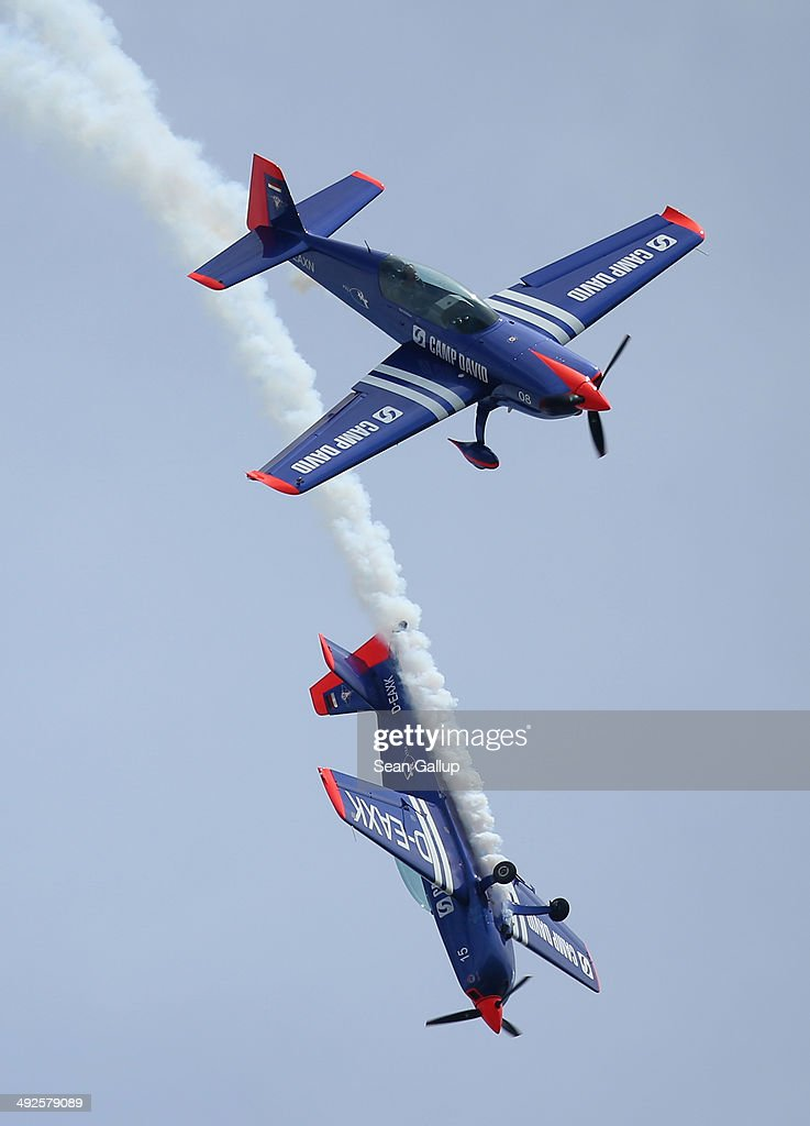 Two Extra 300 aerobatic planes fly at the ILA 2014 Berlin Air Show on May 21, 2014 in Schoenefeld, Germany. The ILA 2014 is open from May 20-25.
