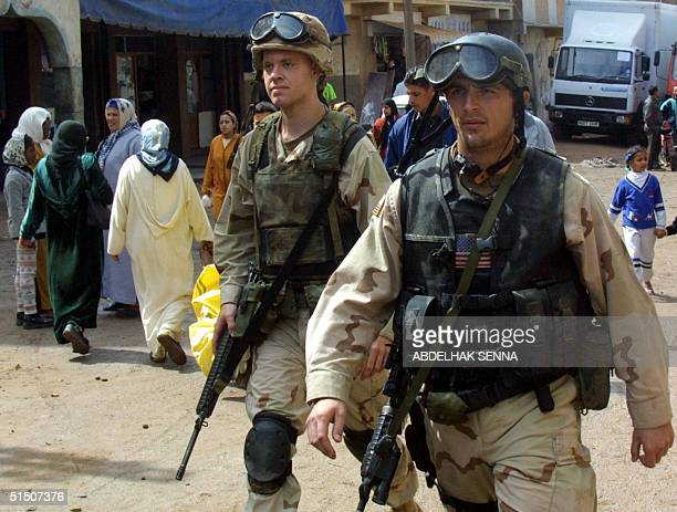 Two extras play supporting roles as US soldiers 28 March 2001 in Sidi Mussa near the city of Sale in US director Ridley Scott's movie 'Black Hawk...